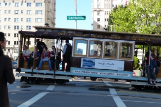 Cable cars share the streets in San Francisco, California.